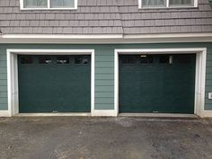 These Overhead Door Model 195 Flush Doors Look Stunning On This House.  Colored Garage Doors Are Becoming More Popular Each Day.