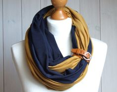 etsy find of the day | FLASH FIND 2 | 1.9.14 bi-color infinity scarf with leather cuff by zojanka zojanka carries a ton of infinity scarf options in many color combinations — i really like this brewers-hued one with its honey leather cuff. this lightweight jersey piece would be a great way to add a punch of color to an outfit :) check out all their options as well as their funky jewelry and accessories, if you have time!