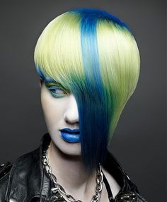 A long blonde straight coloured multi-tonal yellow blue punk avant garde hairstyle by JFK