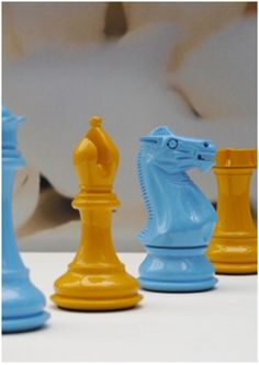 Beautiful yellow and blue colour solid wooden chess sets. An artistic collaboration resulting in this luxurious set. X2078. Feed your mind. Brought to you by ChessBaron.co.uk