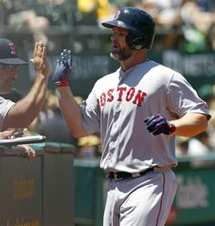 David Ross is greeted at the dugout after hitting a home run against the A's in the 2nd inning on Sunday, JUNE 22, 2014  in Oakland.