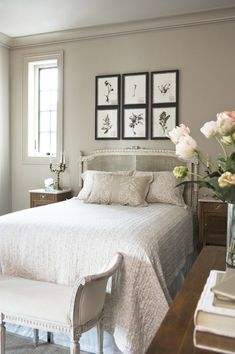 Incredible Neutral Toned Bedroom with an Antiqued French Cane Headboard. Pressed Botanicals Adorn the Taupe Colored Walls - Linda McDougald Design