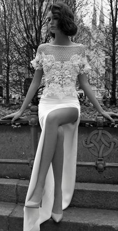Romantic netted neckline slit wedding dress; Featured Dress: Liz Martinez