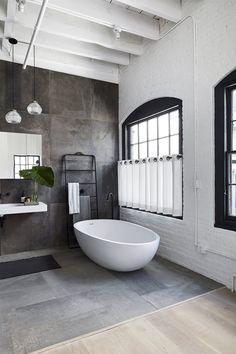 SoHo Loft is a minimal interior design located in Soho, New York, designed by Nusla Design Loft Bathroom, Modern Master Bathroom, Bathroom Flooring, Bathroom Interior, Master Baths, Bathroom Windows, Bathroom Plants, Bathroom Sinks, Small Bathroom