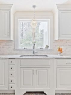 Chandelier/ pendant light above sink
