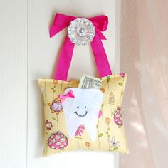 Girls Tooth Fairy Pillow in Pink and Yellow. I like that its hung on a door. Don't have to sneek in their room this way.