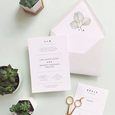modern and minimal invite with greenery
