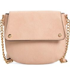 Gold hardware and an adjustable, chain-link strap add sophisticated polish to this blush faux-leather crossbody bag in a structured saddle silhouette.
