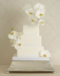 This sophisticated cake by UK-based Peggy Porschen combines sleek square tiers and an opulent display of sculptural white phalaenopsis orchids, all fashioned from sugar. Another stunner!