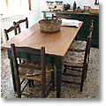 tuscan dining room furniture in the kitchen of an old San Gimignano townhouse, Province of Pisa, Italy