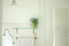 Love the all-white bathroom and the glass shelf