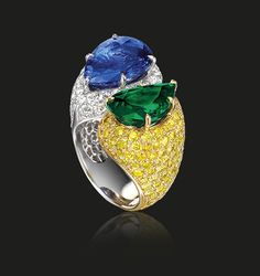 Emerald and Sapphire Ring | Two pear shaped stones of rare quality, uplifted with white and fancy intense yellow diamonds superbly executed by the best of Tabbah's Ateliers craftsmen. Burmese pear shaped sapphire 8.79 cts Columbian pear shaped emerald 4.76 cts  #houseoftabbah #tabbah