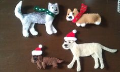 Christmas ornaments of my dogs (corgi and lab-pit mix), and my BFFs' dogs (daschund and husky)