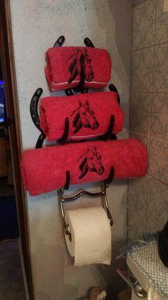 Horseshoe towel holder and horse bit for toilet paper holder.