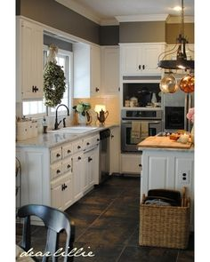 It's amazing what a coat of paint can do to update kitchen cabinets! || via @dearlillie #decor #homedecor #remodel #renovation #homerenovation #kitchenreno #haven #havencof