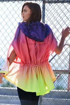 Take on whatever the day brings in complete coverage that's completely cool. The Nike Track & Field Sunset Poncho.