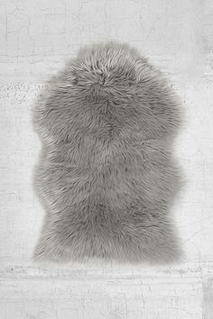 Faux Sheepskin Shaped Rug from Urban Outfitters. Shop more products from Urban Outfitters on Wanelo. Grey Faux Fur Rug, Grey Sheepskin Rug, Urban Outfitters, Fur Bedding, White Bedding, Apartment Essentials, Photoshop, Beige Carpet, Rugs
