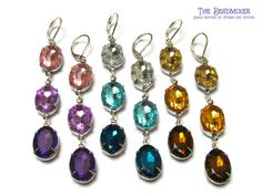 Ombre Rhinestone Earrings Tutorial ~  For one pair of earrings you will need: •6 oval acryllic rhinestones, size  14x10 mm, in 3 different colours  •4 prong settings with 2 eyelets each  •2 prong settings with 1 eyelet (for the rhinestone at the bottom)  •4 open rings, size 4 mm  •a pair of ear studs or ear hooks  •nose pliers to assemble the earrings.  Tutorial/How To @:  http://www.beadmixer.com/Blog_en:Ombre_rhinestone_earrings