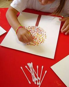 Draw a tree and dip q-tips in different colors of paint and dab to create leaves