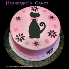 Cheerful Pink Birthday Cake Decorating Idea With Black Cat Motive With Pink Ribbon And Pink Black Floral Accents