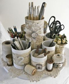 cuts of PVC pipe. Spray paint or wrap with ribbon or fabric or scrapbook paper. glue the whole thing together we a cute storage container on a table