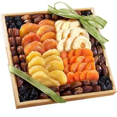 Dried fruit favorites: dried peaches, dried apples, dried pears and dried apricots Framed with buttery dates and pitted prunes Presented in a reusable wooden crate with carved handles Golden State Fruit Mosaic Dried Fruit Gift Tray Healthy Gourmet, Gourmet Food Gifts, Gourmet Recipes, Fruit Recipes, Dried Pears, Dried Fruit, Sun Dried, Fruit Gifts, Fruit Snacks