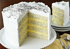 The Galley Gourmet: Lemon Poppy Seed Lady Cake. Made this cake for my mom's birthday and it turned out very well. She asked for it specifically, and it was just what she had a taste for. the cake was very firm and the poppyseeds gave it a little bitterness, to my taste buds.  I used store bought lemon curd for the filling and it was SO worth it.