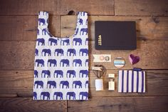 Like the idea of a tote, and the thumb drive would be a good way to give them album design templates, sample client correspondence, love the scissors/twine gift too. Sort-of like the idea of a small gift. -j