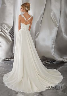 Morilee   Madeline Gardner, Meera Bridal Gown. Perfect for a Destination or Beach Wedding, This Silky Chiffon A-Line Wedding Dress Features a Crystal Beaded and Embroidered Sweetheart Neckline Bodice with Criss-Cross Appliquéd Straps. Available in: White, Ivory, Ivory/Light Gold. Shown with Morilee Head Piece. Style 6867.