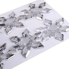 Self adhesive clear snowflakes > 6pcs x 45mm or 12pcs x 25mm per pack - all self adhesive > Looks great on wedding invites, birthday cards or can be used for scrapbooking * VISIT OUR ETSY CRAFTS STORE - View other great craft items for sale in our Etsy store * FAST SHIPPING - We