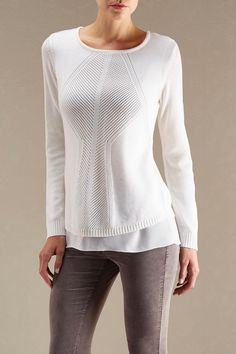 A lace up back and chiffon under layer hemline increase the trend appeal of this pointelle knit sweater. #shopversona #sweaterweather