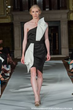 Lenie Boya London Fashion Week S/S 2015. Black dress with 3D Calla Lily details.