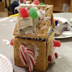 Gingerbread house for a class to do. Use a milk carton as the base for graham crackers and let the kids do the decorating!