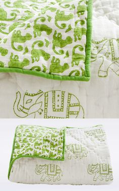 Baby blanket with whimsical Indian elephants on one side and monkeys on the other.