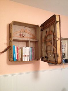 My daughter's ingenious idea for repurposing vintage luggage. #DIY #decor