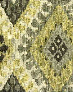 Woven jacquard fabric featuring southwestern ikat style geometric diamond designs in gray, brown, and lime on a natural background. This durable fabric is ideal for couch and chair upholstery, heavy curtains and draperies, valances, bedskirts, pillows, and more. Medium-heavy drape.