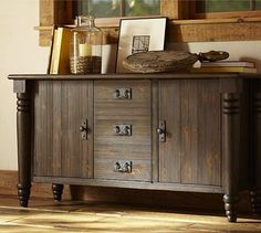 "With the dramatic turned legs of a dining table and the drawers and cabinets of a utility chest, our console combines grand presentation with ample storage space. It feature our exclusive Antique Espresso finish, which is wire brushed and sanded for a burnished look, with hints of dark honey visible below the glazed espresso.        * 56"" wide x 18"" deep x 30"" high      * Handcrafted with a kiln-dried wood frame.      * Finish is layered by hand for exceptional depth of color.      * Fitted…"