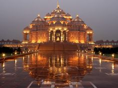 Largest Hindu temple in the world: Delhi Akshardham, Noida Mor, New Delhi, India. The central feature of the complex is the ornately hand-carved stone temple, or mandir Indian Temple, Hindu Temple, Temple India, Buddha Temple, Places Around The World, The Places Youll Go, Around The Worlds, Indian Architecture, Amazing Architecture