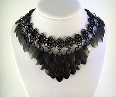Inspiration for a dragonscale necklace... Awesome for a raven costume!!!