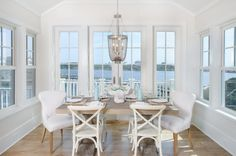 Benjamin Moore Divine White. A room wrapped of windows provide ample opportunities to take in the outdoor beauty.