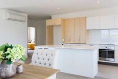 The wooden-white combo kitchen cupboard  panels create a lovely contrast. We like! #ClassicBuilders #KitchenDesign