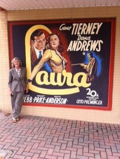 Susan Andrews in Huntsville, TX next to a mural featuring LAURA,  the film that made her father a star. I relied on Susan a good deal in writing my biography, HOLLYWOOD ENIGMA: DANA ANDREWS. She joined me on my Texas book tour.