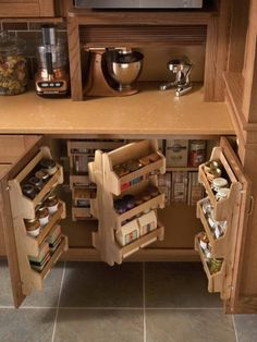 Love the spice racks. I would want them on upper cabinets.