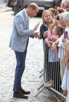 Father-of-two Prince William exchanges a wave with a young fan outside Truro…
