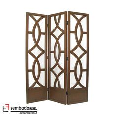 Bass wood room divider with geometric overlays. Product: Room divider Construction Material: Bass wood Color: Brown Features: Hand-finished to ensure premium quality Attractive twist on the classic screen Hand-painted Dimensions: H x W (overall) Wood Room Divider, Panel Room Divider, Folding Room Dividers, Bamboo Blinds, Wood Shutters, Oriental Furniture, Living Room Windows, Wood Slats, Brown Wood
