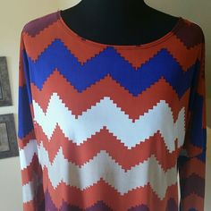 LAST DAY ON POSH -Colorful Aztec Print Tunic Super cute Aztec Print Hi-Lo Tunic. Made in USA. Purchased from another Posher new and worn once. Polyester/spandex blend. 3 quarter sleeve. I did cut out the plastic hang tie inside.  Otherwise in excellent condition.  33 inches long in back and 25 in front. Orange,  royal blue, white, tan and maroon. Moa Tops Tunics