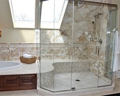 Tub surround extends into shower to make a bench. Really like the square tile, and the contrast between the tile section and the wood section.