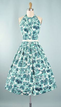 ♦ Vintage 1950s - 60s Novelty Print Sundress by Fashioned by Lampl. ♦ Constructed in a White Cotton Pique Fabric with a Scenic Cottage Print in Black & Turquoise Blue. ♦ Halter Top Bodice with a Button Front Closure ♦ Original Adjustable to Any Size, Matching Belt. ♦ Fitted Waist with a Pleated Full Skirt. ♥ PLS. Enlarge & ZOOM into All Photos, For a Better Detail of this Item! ♥~~~~~~SHIPPING~~~~~♥ United States $7.00 USPS Priority Mail. Canada $17.00 USPS First Class. Internat...