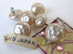 Vintage glass pearl buttons.