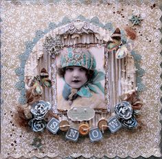 Snow ~ Sweet heritage child's page with a great vintage winter look. Love the punched frame and borders, glitter and puff paint embellishments.